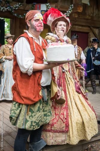 Her Majesty tasting the cake.